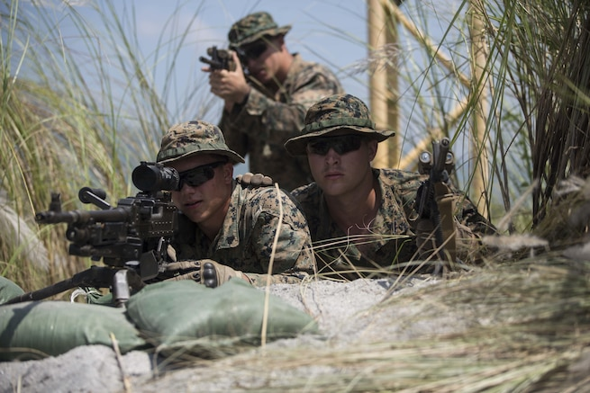 U.S. Marines sight in during platoon movement at Crow Valley, Philippines, Oct. 2, 2015, as part of Amphibious Landing Exercise 2015. The Marines are assigned to Echo Company, 2nd Battalion, 5th Marine Regiment. U.S. Marine Corps photo by Lance Cpl. Juan Bustos