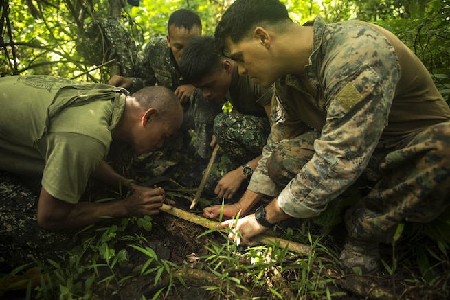 U.S. and Philippine Marines start a fire using bamboo during jungle survival training as part of Amphibious Landing Exercise 2015 in Ternate, Philippines, Sept. 29, 2016. The Marines learned basic jungle survival skills, such as building a fire, finding sources of fresh water and catching food. The training exercise aims to strengthen the interoperability and working relationships across a wide range of military operations. U.S. Marine Corps photo by Cpl. Joey S. Holeman Jr.