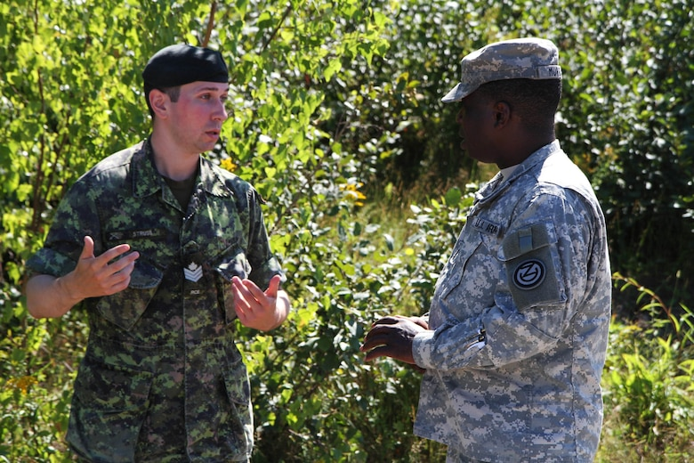 Sgt. 1st Class Oniel Murray, 1st Engineer Brigade, 102nd Training Division, 80th Training Command, discusses the differences in teaching techniques with his Canadian counterpart, Canadian Armed Forces Sgt. Corey Struss at the Canadian Forces School of Military Engineering at Canadian Forces Base Gagetown in New Brunswick, Canada, as part of an instructor exchange initiative between the U.S. and the CFSME, spearheaded by 1st Brigade Engineers.
