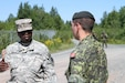 Sgt. 1st Class Oniel Murray of the Fort Leonard Wood, Mo., 1st Brigade Engineers discusses the differences in teaching techniques with his Canadian counterpart, Canadian Armed Forces Sergeant Corey Struss at the Canadian Forces School of Military Engineering (CFSME) at Canadian Forces Base Gagetown in New Brunswick, Canada, as part of an instructor exchange initiative between the U.S. and the CFSME, spearheaded by 1st Brigade engineers.