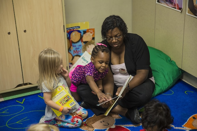 A teacher reads with her students at the child development center aboard Marine Corps Air Station Beaufort Sept. 23. MilitaryChildCare.com is a new website that will provide parents with comprehensive information on military operated child care options. Military families around the world will be able to research and sign up for child care programs.