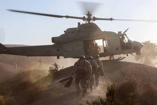 U.S. Marines conduct a helocast exercise out of a UH-1Y Venom at Ferguson Lake near Yuma, Ariz., Oct. 3, 2015. The exercise is part of  a seven-week weapons and tactics event to provide standardized tactical training and certify instructors to support readiness. U.S. Marine Corps photograph by Staff Sgt. Artur Shvartsberg