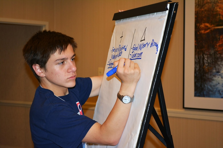 Gregory Peloquin, son of Col. Marisa Peloquin, commander, 97th Training Brigade, participates in a breakout session during a joint teen council meeting, Alexandria, Va., July 28, 2015. Peloquin and nine other members of the 80th Training Command Teen Council attended the meeting with members of the 412th Theater Engineer Command and the 75th Training Command teen councils.