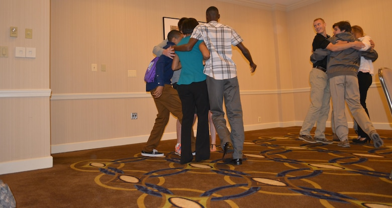 Members of the 80th Training Command Teen Council participate in a game called protons and neutrons during a joint meeting with members of the 412th Theater Engineer Command and the 75th Training Command teen councils in Alexandria, Va., July 28, 2015. The meeting afforded the 80th TC teens an opportunity to share their ideas, challenges, and best practices with members of the 75th TC and the 412th TEC councils.