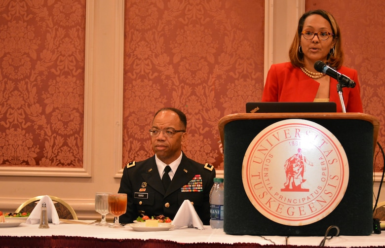 Hon. Tiffany Johnson-Cole, Tuskegee, Ala., municipal court judge, introduces Maj. Gen. A. C. Roper, commander 80th Training Command, during the Tuskegee University: Centennial Awards Leadership Banquet where Roper delivered the keynote address, Tuskegee, Ala., Sept. 24, 2015. The banquet marked the culmination of the 20th Annual Booker T. Washington Economic Development Summit.