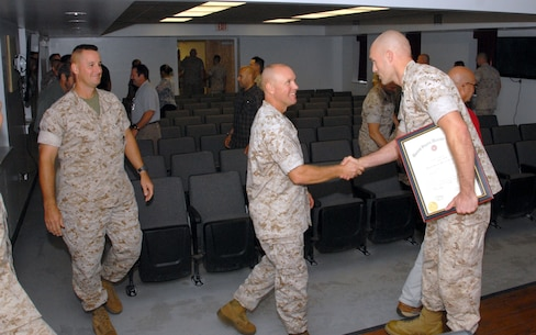 On October 1, 2015 Colonel Scott A. Baldwin, Commanding Officer of Marine Corps Engineer School; congratulates Combat Engineer Instruction Company instructor William E. Satterfield on his promotion to the rank of Gunnery Sergeant aboard Marine Corps Engineer School, Camp Lejeune, North Carolina.