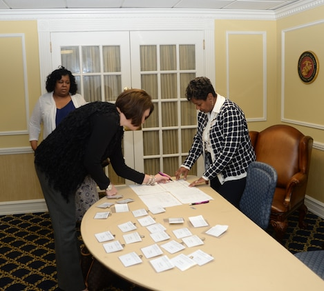 Veronica Curtis Richie (right), professional development trainer, Military Child Education Coalition, Harker Heights, Tex., assists area educators, counselors, agency directors and other supporters to register for a full day of training at Marine Corps Logistics Base Albany's Conference Center, Oct 5. The training was scheduled to teach techniques to assist transitioning military children to reach their full potential.