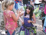 A child visits with a fairy at the 2014 Kansas Renaissance Festival.