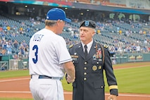 Ned Yost, Kansas City Royals manager, and Maj. Gen. Wayne W. Grigsby Jr., 1st Inf. Div. and Fort Riley commanding general, shake hands after Yost presented Grigsby with a game ball Sept. 7 during pre-game ceremonies as part of the Royals' Armed Forces Night at Kauffman Stadium in Kansas City, Missouri. Service members representing every branch of the Armed Forces accepted game balls from Yost and Royals players.