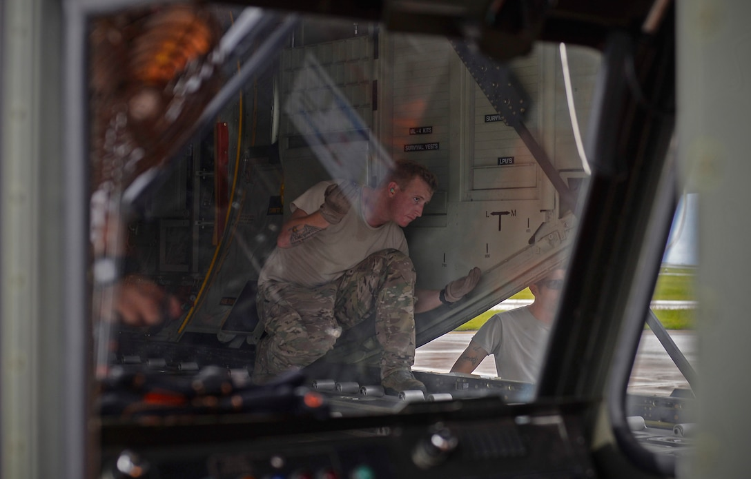 A 17th Special Operations Squadron MC-130J Commando II loadmaster, guides the driver of a load carrier toward a MC-130J Commando II during an exercise Sept. 18, 2015, at Andersen Air Force Base, Guam. The MC-130H was part of a dissimilar formation with an MC-130J that completed a Maritime Craft Aerial Delivery System airdrop.  This was the first time an MC-130J Commando II completed the MCADS airdrop in the Pacific. (U.S. Air Force photo by Staff Sgt. Alexander Riedel)