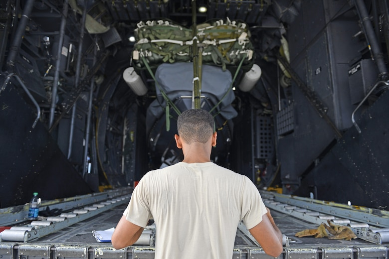 A 1st Special Operations Squadron loadmasters, fastens the parachute rigging of a speed boat to the loading ramp of a MC-130H Combat Talon II during an exercise Sept. 18, 2015, at Andersen Air Force Base, Guam.  The MC-130H was part of a dissimilar formation with an MC-130J that completed a Maritime Craft Aerial Delivery System airdrop.  This was the first time an MC-130J Commando II completed the MCADS airdrop in the Pacific.   (U.S. Air Force photo by Staff Sgt. Alexander Riedel)
