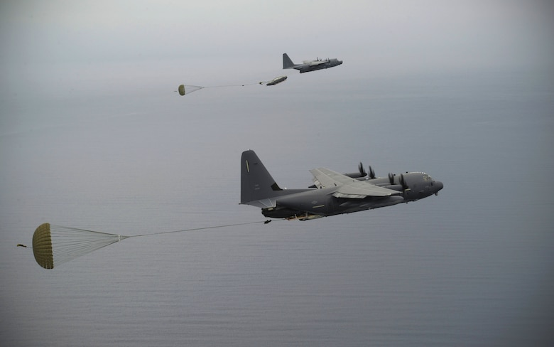 A U.S. Air Force MC-130J and MC-130H crew drop a watercraft and supplies during an exercise Sept. 19, 2015, over the Pacific Ocean.  This was the first time an MC-130J Commando II completed the Maritime Craft Aerial Delivery System airdrop in the Pacific. (U.S. Air Force photo by Airman 1st Class Alexa Ann Henderson)