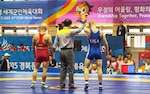 U.S. wrestler Cole VonOhlen wins the 65kg men's freestyle wrestling match against Macedonian Ile Georgiev at the sixth CISM World Games in Mungyeong, Korea