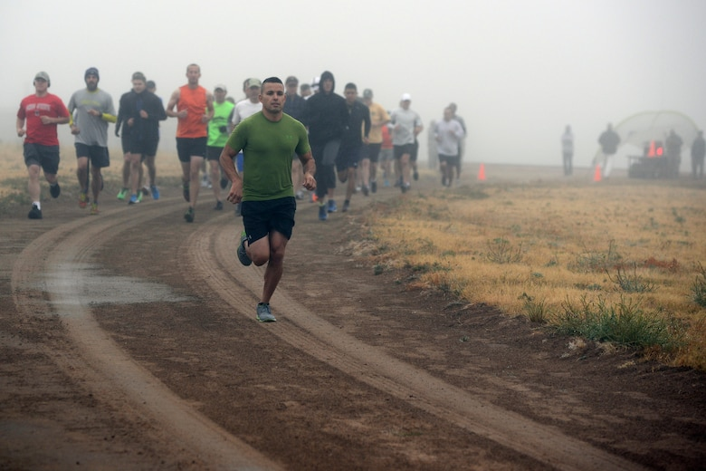 Nicholas Ruiz leads the way as competitors begin the 10th annual half marathon at Schriever Air Force Base, Colorado, Friday, Oct. 2, 2015. Ruiz won the event with a time of 1:31:37, as 40 runners braved the elements to participate.  (U.S. Air Force photo/Christopher DeWitt)