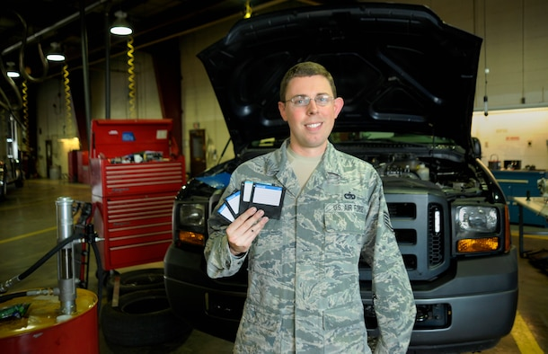 Oregon Air National Guard Tech. Sgt. Andrew Saunders, a Vehicle Management and Analysis specialist for the 142nd Fighter Wing, shows off  a set of floppy disks used to run the On-Line Vehicle Interactive Management System (OLVIMS), a legacy system that is being phased out of use due in part to Saunders' efforts., Oct. 3, 2015, Portland Air National Guard Base, Ore. (U.S. Air National Guard photo by Staff Sgt. Brandon Boyd, 142nd Fighter Wing Public Affairs/Released)