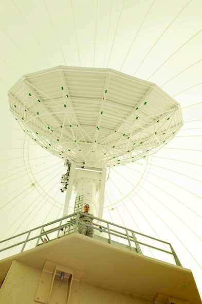 Capt. Joel Chalmers, Vandenberg Tracking Station flight commander, stands inside the radome, Friday, Oct. 2, 2015, at Vandenberg Tracking Station, aka COOK. As a child, he marveled at the radome's size as he began to realize what space operations bring to the world. (U.S. Air Force photo/Staff Sgt. Jim Araos)