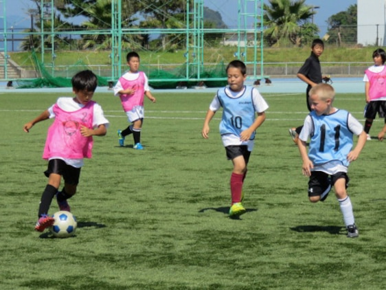 Japanese children from schools in the local area and children from Marine Corps Air Station, Iwakuni, Japan, participate in the Japan-U.S. Friendship Kid's Soccer Event coordinated by the Chugoku-Shikoku Defense Bureau at the Suo-Oshima Town Athletics Track and Field in Yamaguchi Prefecture, Japan, Sept. 27, 2015. This annual event serves as an opportunity for American and Japanese children to interact and help build bonds between the people of the U.S. and Japan.