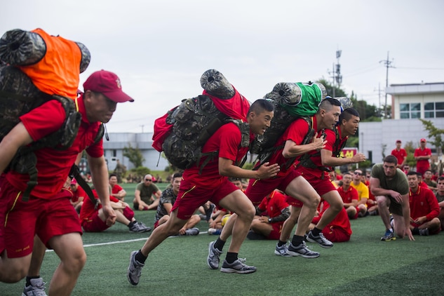 U.S. and Republic of Korea Marines cheer on participants in a ruck run relay race during Korean Marine Exchange Program 15-12 at Chung Ryong, Republic of Korea, Sept. 12, 2015. KMEP 15-12 is a continuous bilateral training exercise that enhances the ROK and U.S. alliance, promotes stability on the Korean Peninsula and strengthens ROK and U.S. military capabilities and interoperability. The ROK Marines are with 11th Battalion, 1st Regiment, 2nd Marine Division. The U.S. Marines are with 2nd Battalion, 3rd Marine Division, currently attached to 4th Marine Regiment, III Marine Expeditionary Force through the Unit Deployment Program.