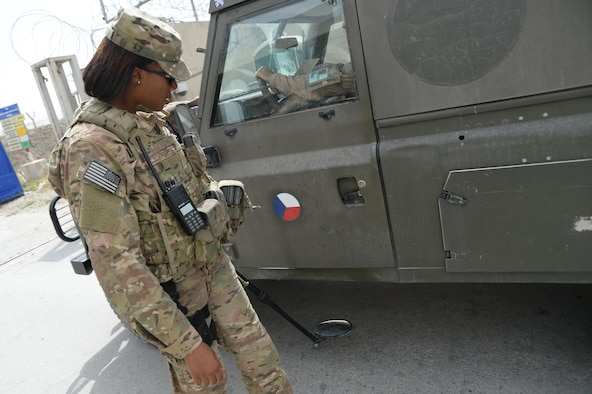 Staff Sgt. Devondria Dean, Train, Advise, Assist Command – Air (TAAC-Air) Guardian Angel member, does a security sweep of a vehicle at a checkpoint at Hamid Karzai International Airport in Kabul, Afghanistan, Sept.20, 2015. G.A.s provide over-watch for TAAC-Air advisors and contractors training Afghan Air Force Airmen.  (U.S. Air Force photo by Staff Sgt. Sandra Welch/released)