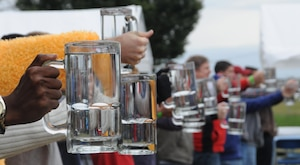 Employees of the National Air and Space Intelligence Agency, participate in a stein raise contest, during the center's 47th Annual Oktoberfest celebration at Bass Lake, Oct. 2, 2015. Employees participated in other events as well, such as a keg toss, log-saw and tug-of-war. (U.S. Air Force photo by Staff Sgt. Marianne E. Lane)