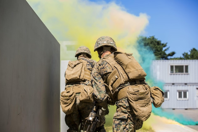 U.S. Marines and ROK Marines breach a building under smoke concealment during Korean Marine Exchange Program 15-12 at Gunha-Rhi, Gimpo, Republic of Korea, Sept. 17, 2015. KMEP 15-12 is a bilateral training exercise that enhances the ROK and U.S. alliance, promotes stability on the Korean Peninsula and strengthens ROK and U.S. military capabilities and interoperability. The ROK Marines are with 1st Company, 11th Battalion, 1st Regiment, 2nd Marine Division. The U.S. Marines are with Fox Company, 2nd Battalion, 3rd Marine Regiment, currently assigned to 4th Marine Regiment, 3rd Marine Division, III Marine Expeditionary Force under the unit deployment program.