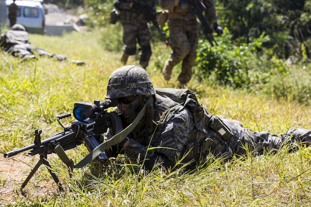 Republic of Korea Marine Sgt. Joongheon Kim provides security for U.S. and ROK Marines crossing a simulated danger zone during Korean Marine Exchange Program 15-12 at Gunha-Rhi, Gimpo, Republic of Korea, Sept. 17, 2015. KMEP 15-12 is a bilateral training exercise that enhances the ROK and U.S. alliance, promotes stability on the Korean Peninsula and strengthens ROK and U.S. military capabilities and interoperability. Kim, from Changwon, ROK, is a machine gunner with 1st Company, 11th Battalion, 1st Regiment, 2nd Marine Division. The U.S. Marines are with Fox Company, 2nd Battalion, 3rd Marine Regiment, currently assigned to 4th Marine Regiment, 3rd Marine Division, III Marine Expeditionary Force under the unit deployment program.