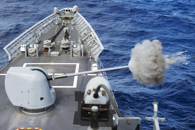 The USS Chancellorsville fires its MK 45 5-inch gun during a live-fire gunnery exercise in waters south of Japan, Sept. 30, 2015. The Chancellorsville is on patrol in the U.S. 7th Fleet area of responsibility in support of security and stability in the Asia-Pacific region. U.S. Navy photo by Petty Officer 2nd Class Raymond D. Diaz III