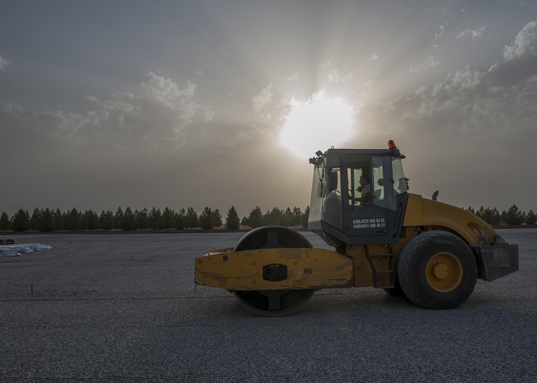 Staff Sgt. Adam Borjon, a 435th Construction Training Squadron engineer system's operator, rolls gravel Sept. 13, 2015, at Diyarbakir Air Base, Turkey. The 435th CTS falls under the 435th Contingency Response Group at Ramstein Air Base, Germany. The group is deployed in support of the U.S. Air Force staging of aircraft and Airmen at Diyarbakir AB in southeast Turkey to enhance coalition capabilities to support personnel recovery operations in Syria and Iraq. (U.S. Air Force photo/Airman Cory W. Bush)