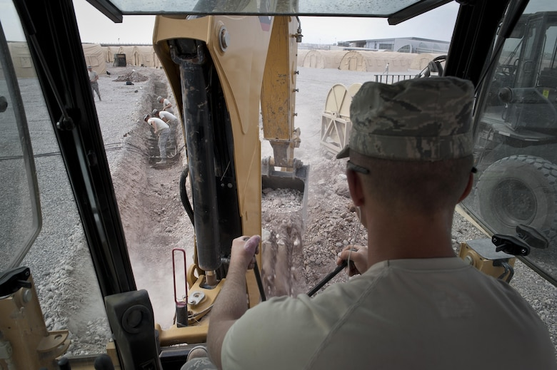 Staff Sgt. Logan Pals, a 435th Construction Training Squadron military construction flight pavement and equipment operator, digs a trench Sept. 22, 2015, in preparation for personnel recovery operations at Diyarbakir Air Base, Turkey. The 435th CTS falls under the 435th Contingency Response Group at Ramstein Air Base, Germany. The group provides a cross-functional, rapidly deployable airborne force designed to assess and open air bases and perform initial airfield operations enabling rapid standup of combat operations anywhere in the U.S. European Command and U.S. Africa Command's area of responsibilities. (U.S. Air Force photo/Airman Cory W. Bush)