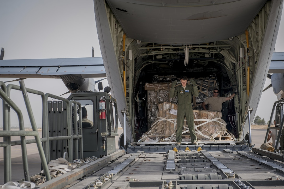 Senior Airman Dustin Dixon, a 435th Contingency Response Squadron loadmaster, directs an aircraft loader during a C-130J Super Hercules off-load of equipment Sept. 12, 2015, at Diyarbakir Air Base, Turkey. Airmen from the 435th Contingency Response Group received more than 680 tons of equipment for base operations in support of the U.S. Air Force's support personnel recovery mission from Turkey. When requested, coalition aircraft and personnel will provide recovery capability to protect and recover coalition members. (U.S. Air Force photo/Airman Cory W. Bush)