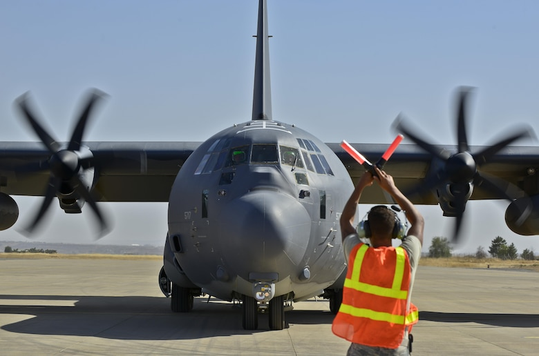 Senior Airman Trenton Mosley, a 435th Contingency Response Squadron contingency response crew chief, marshals a HC-130J Super Hercules Sept. 23, 2015, at Diyarbakir Air Base, Turkey. The aircraft delivered essential cargo to the Turkish installation as part of the U.S. Air Force's staging of operations out of Diyarbakir AB to enhance coalition capabilities to support personnel recovery operations in Syria and Iraq. Diyarbakir AB is a Turkish base home to the Turkish air force's 8th Air Wing. (U.S. Air Force photo/Airman Cory W. Bush)