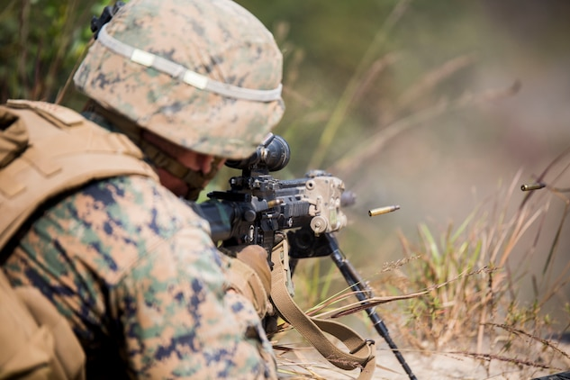 U.S. Marine Lance Cpl. Michael W. Silver provides suppressive fire during Korean Marine Exchange Program 15-12 at Rodriguez Landing Zone, Republic of Korea, Sept. 25, 2015. KMEP 15-12 is a bilateral training exercise that enhances the ROK and U.S. alliance, promotes stability on the Korean Peninsula and strengthens ROK and U.S. military capabilities and interoperability. Silver, from Carrollton, Georgia, is a rifleman with Fox Company, 2nd Battalion, 3rd Marine Regiment, currently assigned to 4th Marine Regiment, 3rd Marine Division, III Marine Expeditionary Force under the unit deployment program.