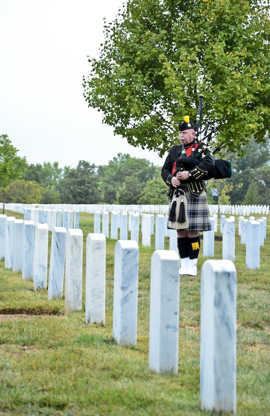 Kevin Donnelly plays the bagpipe at Arlington National Cemetery for the Military Police Corps Regimental Remembrance Ceremony held Sept. 30.  Guests pay special tribute to the Military Police who sacrificed their lives while serving during the last year. (U.S. Army photo taken by Sgt. Elizabeth Taylor/Released)
