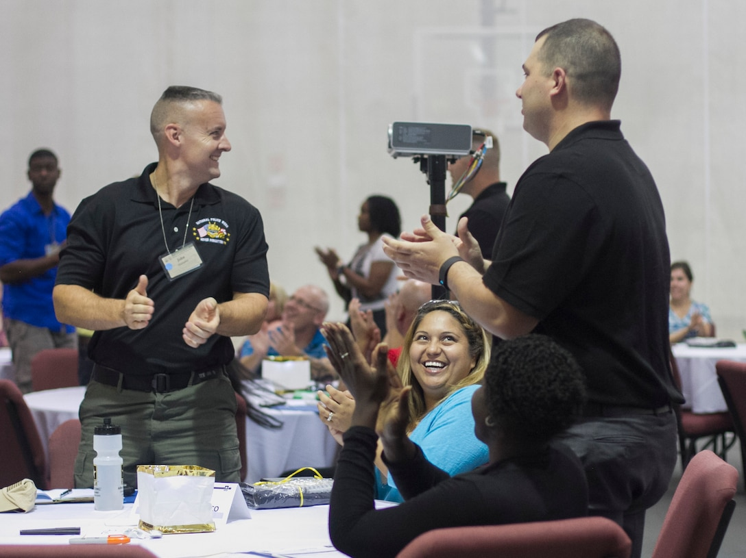 Command teams participating in the 200th Military Police Command's Family Readiness Training in Shepherdstown, W.Va., are celebrated during the welcome ceremony, Sept. 18. The event provided participants with the tools necessary to successfully  develop a Family Readiness Group.