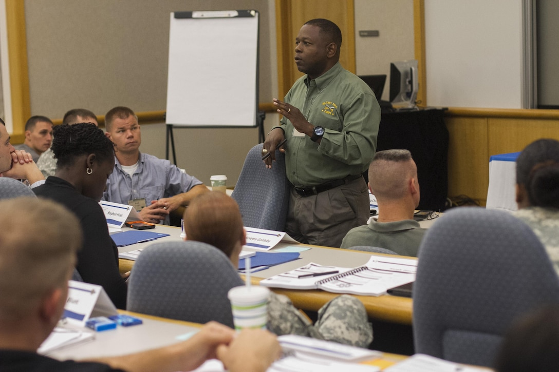Maj. Gen. Phillip M. Churn. the commanding general for the 200th Military Police Command, briefs the command teams at the Family Readiness Training event in Shepherdstown, W.Va., about his expectations for the unit Family Readiness groups moving forward, Sept. 19.  The event provided participants with the tools necessary to successfully  develop a Family Readiness Group.