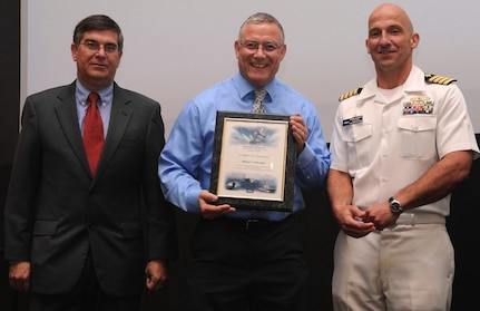 DAHLGREN, Va. - Mike McDonald receives his certificate of achievement from Naval Surface Warfare Center Dahlgren Division (NSWCDD) Technical Director Dennis McLaughlin and NSWCDD Commanding Officer Capt. Brian Durant at the annual command academic awards ceremony, Sept. 21. The NSWCDD engineer - and his wife, Janette Calo - were recognized for completing a master's degree in systems engineering  and commended for commitment to their personal and professional development.