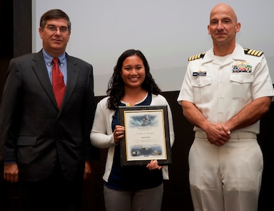 DAHLGREN, Va. - Abby Mohle receives her certificate of achievement from Naval Surface Warfare Center Dahlgren Division (NSWCDD) Technical Director Dennis McLaughlin and NSWCDD Commanding Officer Capt. Brian Durant at the annual command academic awards ceremony, Sept. 21. The NSWCDD engineer - and her husband, Drew - were recognized for completing a master's degree in systems engineering  and commended for commitment to their personal and professional development.