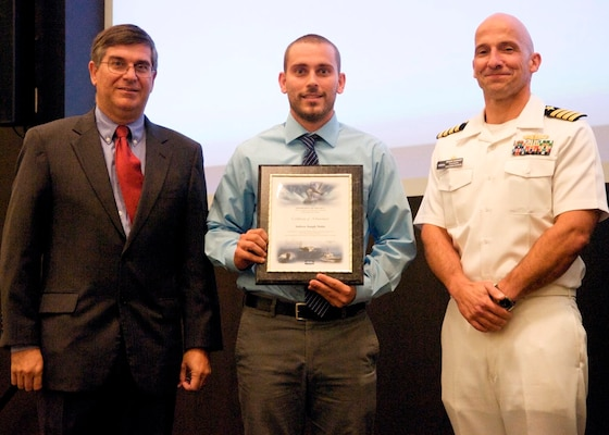 DAHLGREN, Va. - Drew Mohle receives his certificate of achievement from Naval Surface Warfare Center Dahlgren Division (NSWCDD) Technical Director Dennis McLaughlin and NSWCDD Commanding Officer Capt. Brian Durant at the annual command academic awards ceremony, Sept. 21. The NSWCDD engineer - and his wife, Abby - were recognized for completing a master's degree in systems engineering and commended for commitment to their personal and professional development.