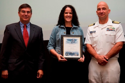 DAHLGREN, Va. - Janette Calo receives her certificate of achievement from Naval Surface Warfare Center Dahlgren Division (NSWCDD) Technical Director Dennis McLaughlin and NSWCDD Commanding Officer Capt. Brian Durant at the annual command academic awards ceremony, Sept. 21. The NSWCDD engineer - and her husband, Mike McDonald - were recognized for completing a master's degree in systems engineering  and commended for commitment to their personal and professional development.