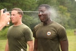 A Marine with 1st Battalion, 8th Marine regiment begins the non-lethal instructor course by being sprayed with Oleoresin Capsicum (OC) spray at Camp Lejeune, N.C., Sept. 30, 2015. Although being temporarily blind from the OC spray the Marines are still required to finish this course in less than four minutes.