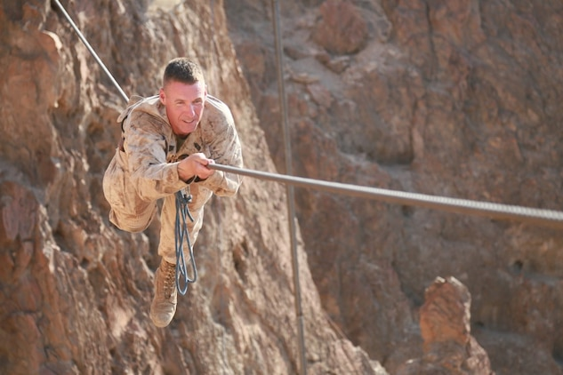ARTA BEACH, Djibouti (Sept. 28, 2015) U.S. Marine 1st Sgt. Garett Kirkby balances on a cable obstacle during a desert survival course alongside the French 5th Overseas Combined Arms Regiment (RIAOM). Kirkby is the company 1st Sgt. of Delta Company, 1st Light Armored Reconnaissance Detachment, Battalion Landing Team 3rd Battalion, 1st Marine Regiment, 15th Marine Expeditionary Unit. Elements of the 15th MEU are training with the 5th RIAOM in Djibouti in order to improve interoperability between the MEU and the French military. (U.S. Marine Corps photo by Sgt. Steve H. Lopez/Released)