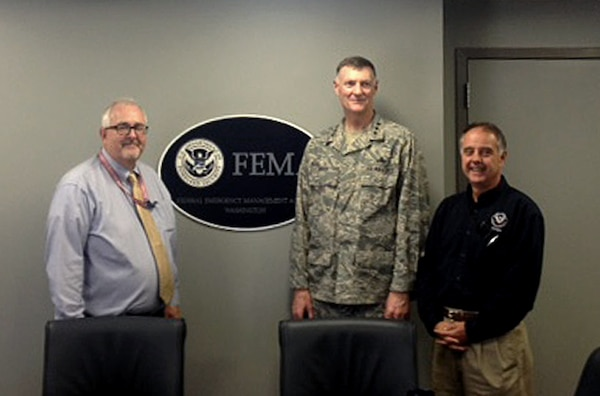 (From left) Federal Emergency Management Agency Administrator Craig Fugate, Defense Logistics Agency Director Air Force Lt. Gen. Andy Busch and FEMA Deputy Administrator Joseph Nimmich meet June 12 at FEMA's headquarters in Washington, D.C. Busch toured the agency's 24/7 National Response Coordination Center, the focal point for national disaster coordination, where he learned firsthand about the support DLA provides to FEMA.