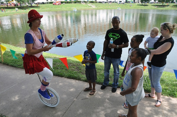 FORT BELVOIR, Va. (June 24, 2015) A juggler performs for 9-year-old Xandria Wickes (right) and her family during the 2015 HQC Family Day June 24 at the McNamara Headquarters Complex. More than 7,500 people attended the event, sponsored by the HQC's Morale, Welfare and Recreation program office.