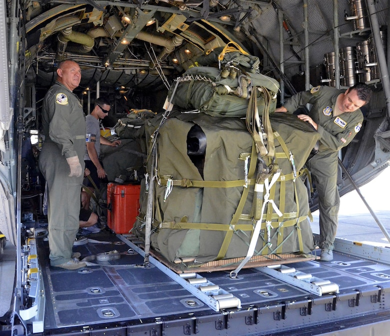 Loadmastsers with the 920th Rescue Wing inspect two RAMZ packs (Rigged Alternate Method Zodiac) in the back of a wing HC-130P/N King aircraft prior to a search-and-rescue mission. The packs each contain an inflatable Zodiac boat, an oxygen tank to inflate the boat, an outboard motor for the boat and medical equipment. When a survivor is spotted in the ocean, the RAMZ are pushed from the rear of the aircraft to parachute into the sea below. A team of pararescuemen follow, and once they've parachuted into the ocean, they assemble the RAMZ and use it to reach and rescue the survivor. (U.S. Air Force photo/Master Sgt. Paul Flipse)
