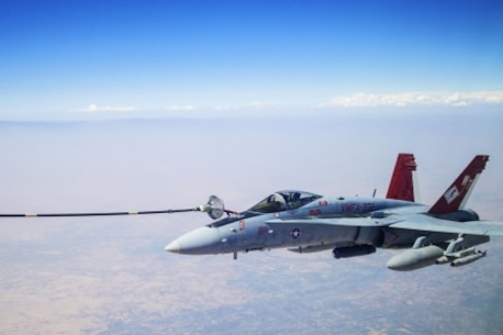 U.S. Marine Corps F/A-18s with Marine Fighter Attack Squadron 232 link up and perform an Air to Air refuel with a Royal Canadian Air Force CC-150 Polaris air-to-air refueller during a combat mission in the skies of Iraq on July 19, 2015. The 'Red Devils' of VMFA-232 are currently deployed with the Special Purpose Marine Air Ground Task Force-Crisis Response-Central Command and provide offensive strike and close air support to Operation Inherent Resolve and the global fight against the Islamic State of Syria and the Levant. (Courtesy Photo by Op IMPACT)