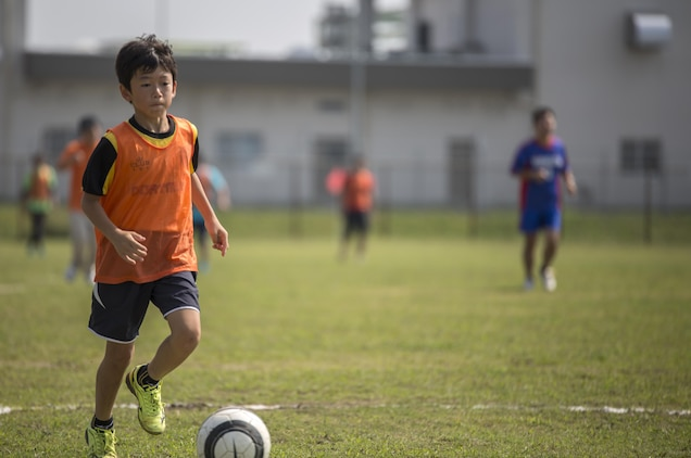 A Special Olympics athlete competes in a soccer game during the Special Olympics Hiroshima at Penny Lake Field at Marine Corps Air Station Iwakuni, Japan, Oct. 4, 2015. Special Olympic activities such as basketball, soccer, cycle racing and bowling, afforded the competitors the opportunity to exhibit their athletic strengths, skills and abilities.