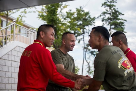 U.S. Marine Lt. Col. Brian P. Coyne, center left, and Republic of Korea Lt. Col. Yoo Hogeun, left, award Capt. Jim C. Wang for winning the soccer competition event at sports day during Korean Marine Exchange Program 15-12 at Chung Ryong, Republic of Korea, Sept. 12, 2015. The Marines participated in a number of events to include a weighted pack run, soccer, basketball and tug of war. KMEP 15-12 is a continuous bilateral training exercise that enhances the ROK and U.S. alliance, promotes stability on the Korean Peninsula and strengthens ROK and U.S. military capabilities and interoperability. Coyne, from Long Island, New York, is the commanding officer of 2nd Battalion, 3rd Marine Division, currently attached to 4th Marine Regiment, III Marine Expeditionary Force through the Unit Deployment Program. Hogeun, from Kangwondo, ROK, is the commanding officer of 11th Battalion, 1st Regiment, 2nd Marine Division. Wang, from Fayetteville, North Carolina, is the company commander for Headquarters and Service Company, 2nd Battalion, 3rd Marine Division, currently attached to 4th Marine Regiment, III Marine Expeditionary Force through the Unit Deployment Program.