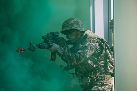 Republic of Korea Marine Cpl. Geon Shin breaches a building alongside U.S. Marines under smoke concealment during Korean Marine Exchange Program 15-12 at Gunha-Rhi, Gimpo, Republic of Korea, Sept. 17, 2015. KMEP 15-12 is a bilateral training exercise that enhances the ROK and U.S. alliance, promotes stability on the Korean Peninsula and strengthens ROK and U.S. military capabilities and interoperability. Shin, from Mokpo, ROK, is a rifleman with 1st Company, 11th Battalion, 1st Regiment, 2nd Marine Division. The U.S. Marines are with Fox Company, 2nd Battalion, 3rd Marine Regiment, currently assigned to 4th Marine Regiment, 3rd Marine Division, III Marine Expeditionary Force under the unit deployment program.