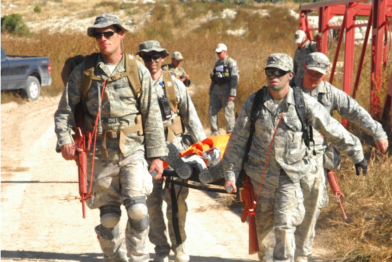 Airmen from the 460th Medical Group use a liter to carry a patient during a training exercise Oct. 3, 2015, at Fort Carson, Colo. The 460th MDG completed annual combat leadership and combat medic training in order to prepare themselves for situations they could find themselves in while deployed in a hostile environment. (Courtesy photo)