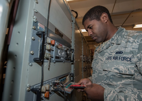 Senior Airman James Brown, 57th Operations Support Squadron airfield systems technician, checks the functionality of a receiver at the Airfield Systems Maintenance compound on Nellis Air Force Base, Nev., Oct. 6, 2015. The receiver, and its transmitter, enables air traffic controllers to maintain communication with pilots in the air. (U.S. Air Force photo by Staff Sgt. Siuta B. Ika)